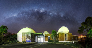 The Milky Way hangs low over Carter Observatory late one night in Wellington, New Zealand.