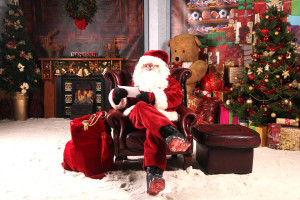 Santa Reading letter on couch - wide shot (2)